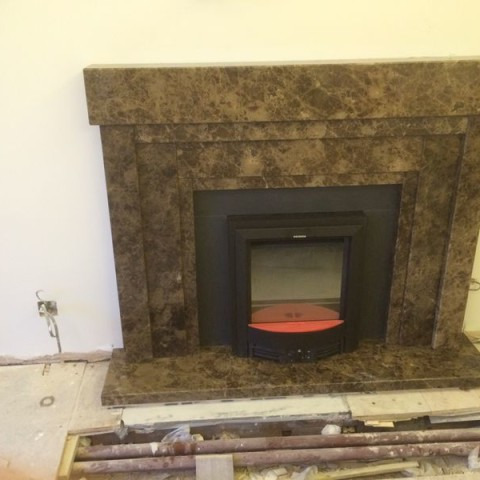 Emperador Dark Marble bespoke made fireplace Fulham, London