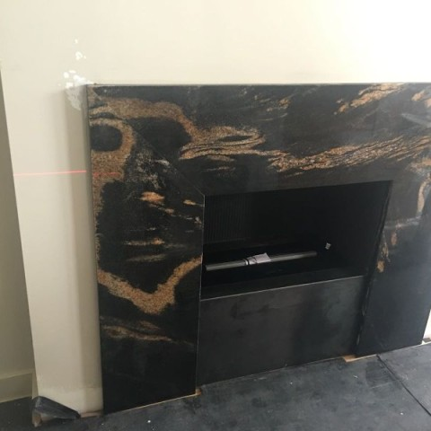 Preto Lotus granite bespoke made fireplace panel, Fulham, London